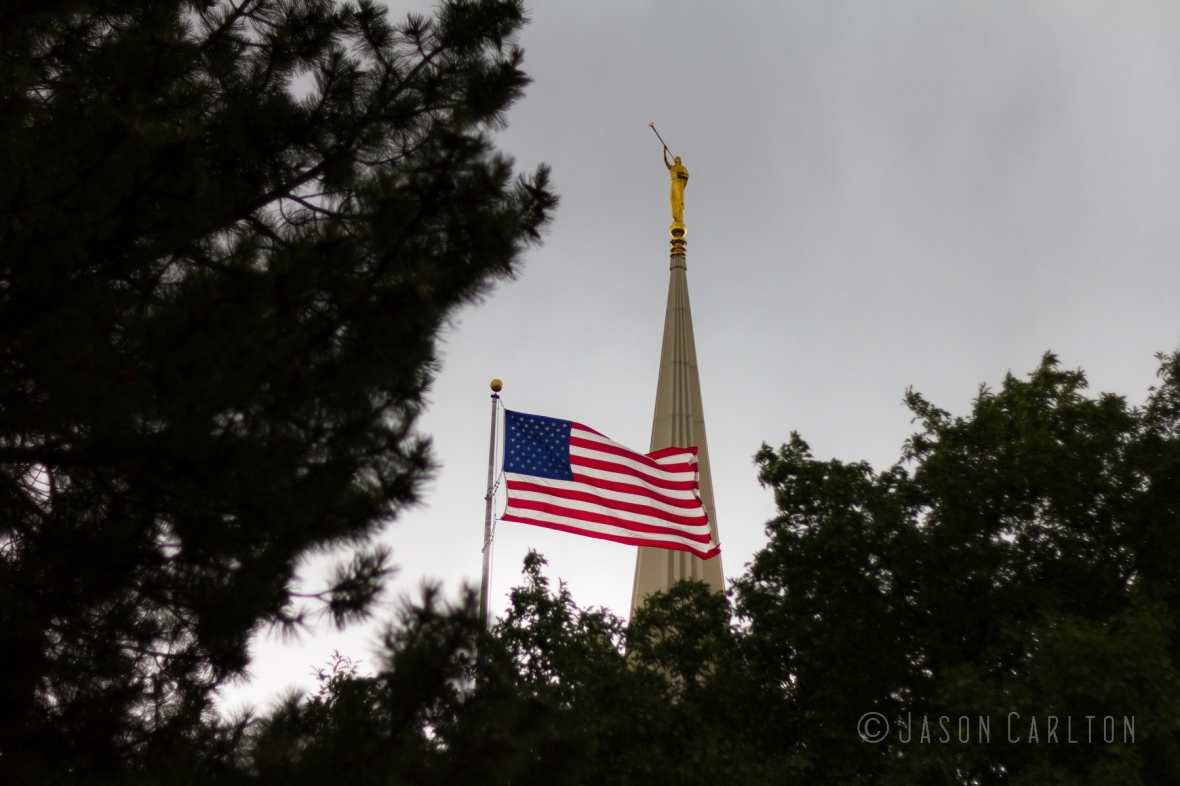 photo of the American flag flying on the Jordan River Utah Temple grounds